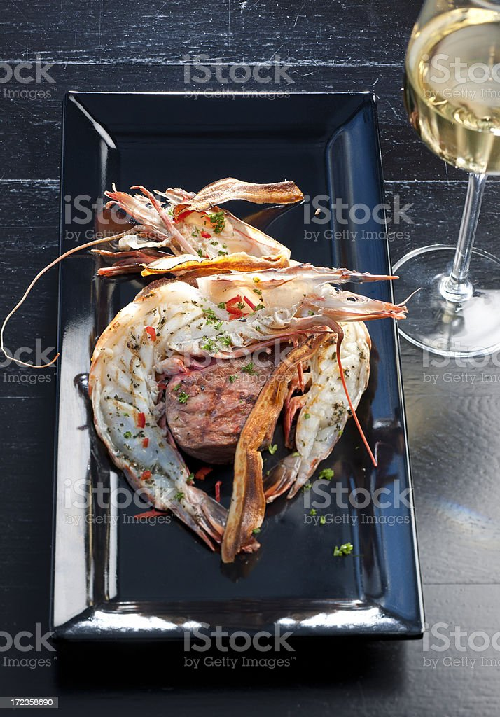 Surf and Turf on dining table royalty-free stock photo