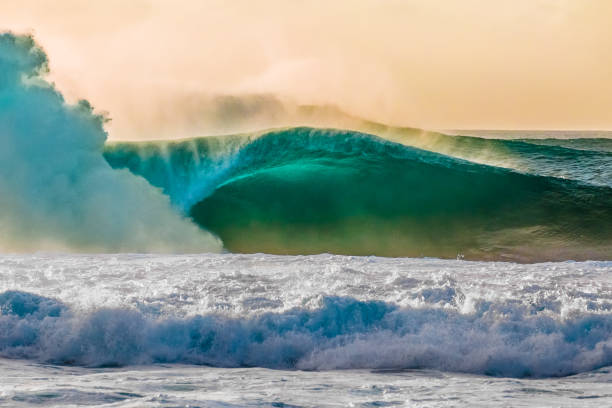 surf at bonzai pipeline on oahu's north shore - wave icon stock photos and pictures