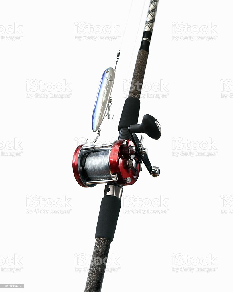 Surf fishing rod, reel and lure on white royalty-free stock photo