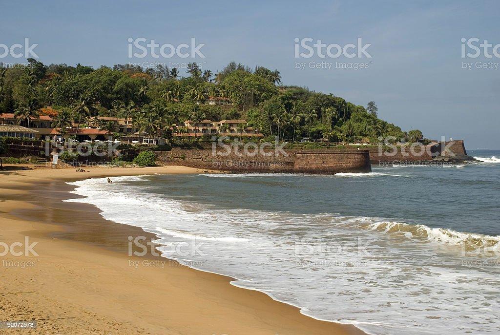 Surf golden sand tropical holiday at Aguada Beach Goa India stock photo
