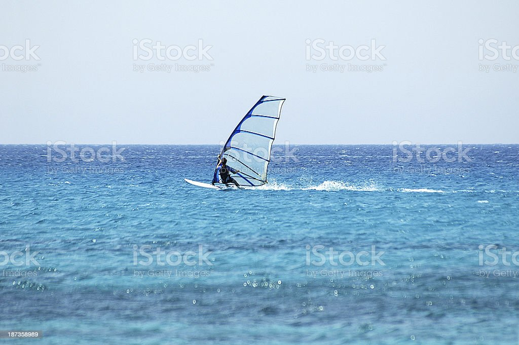 surf in the blue sea royalty-free stock photo