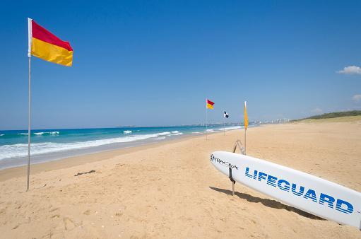 Surf life saving flags and beach