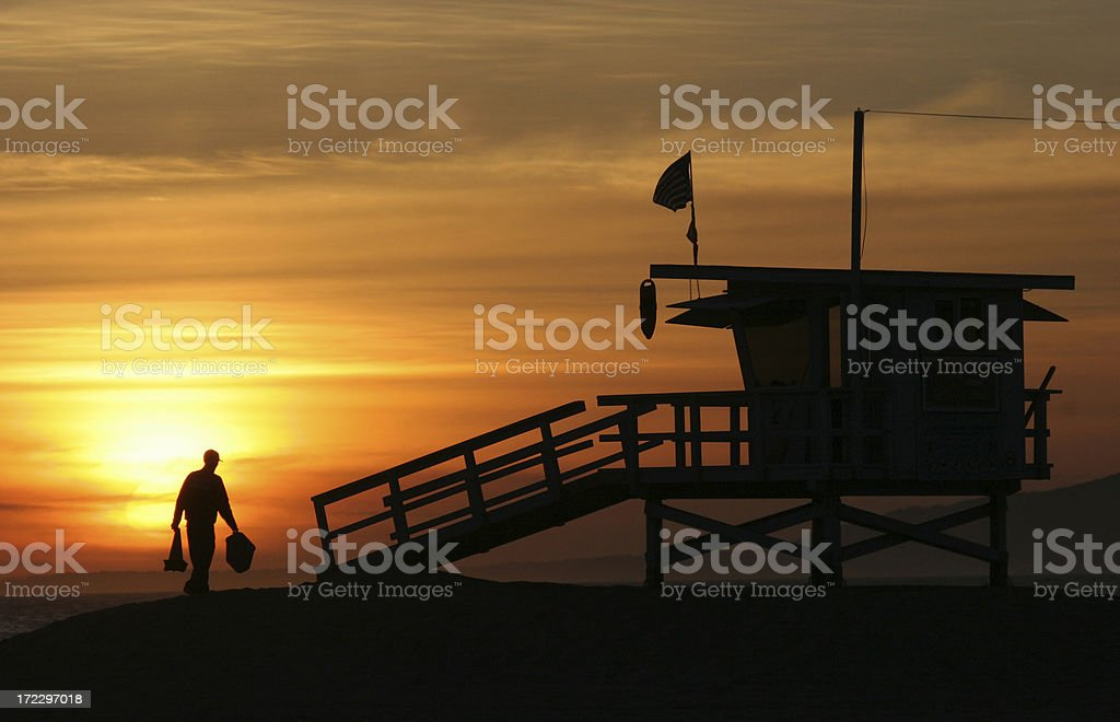 Surf Lifeguard packing up tower stock photo