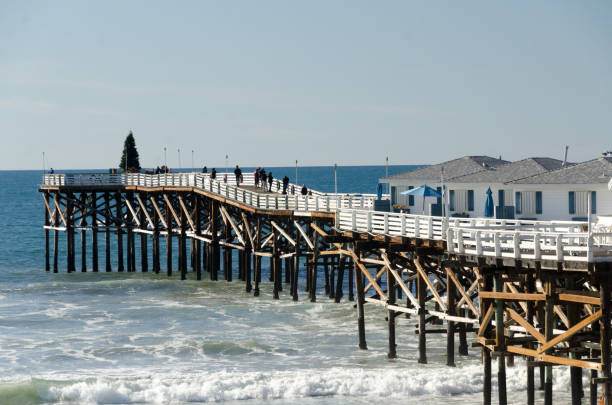 Surf near Crystal Pier on a morning during Christmas holidays, Pacific Beach, San Diego stock photo