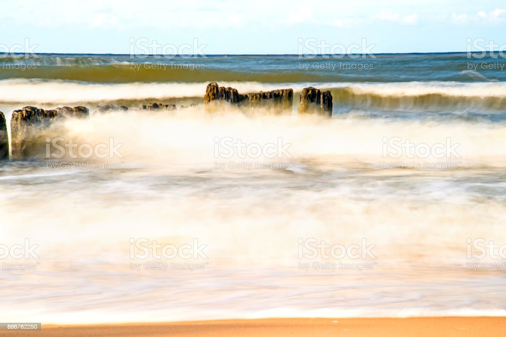 surf of the Baltic sea in long time exposure stock photo