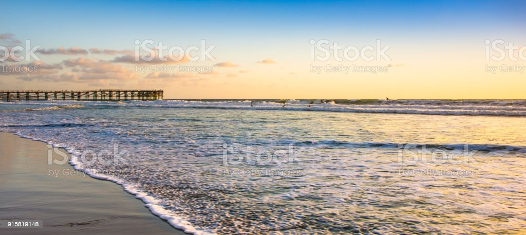 Surf on the beaches of California. Coast near San Diego. Sunset over the ocean Pacific. stock photo