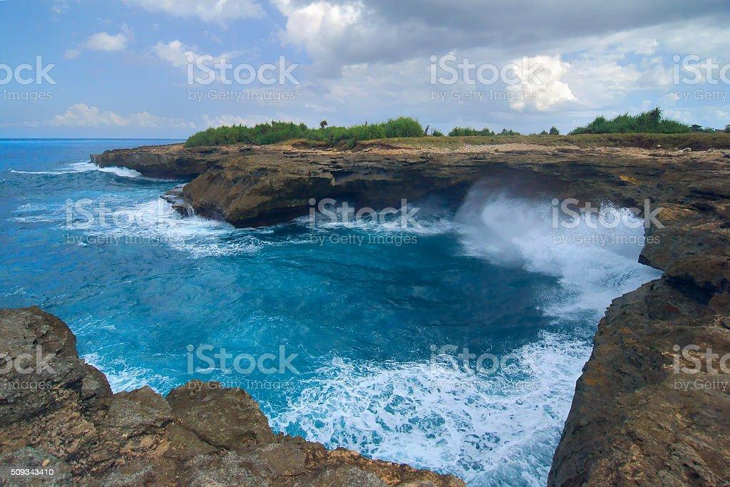 Surf on the rocks near the island Lembongan near Bal stock photo