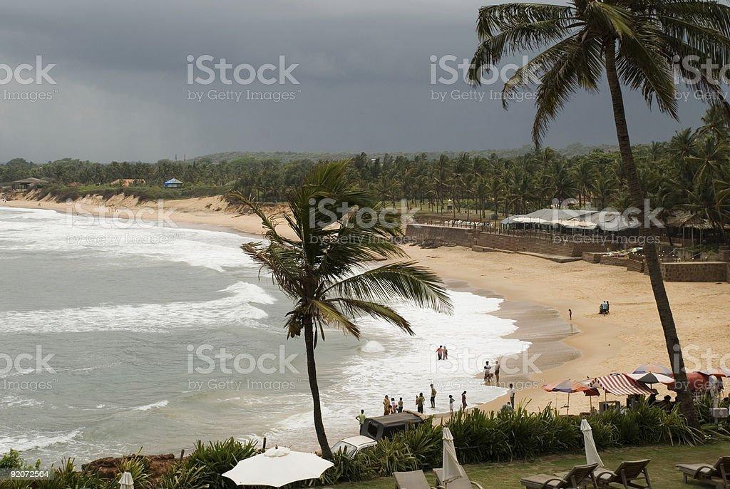Surf sand palm trees tropical holiday Aguada Beach Goa India stock photo