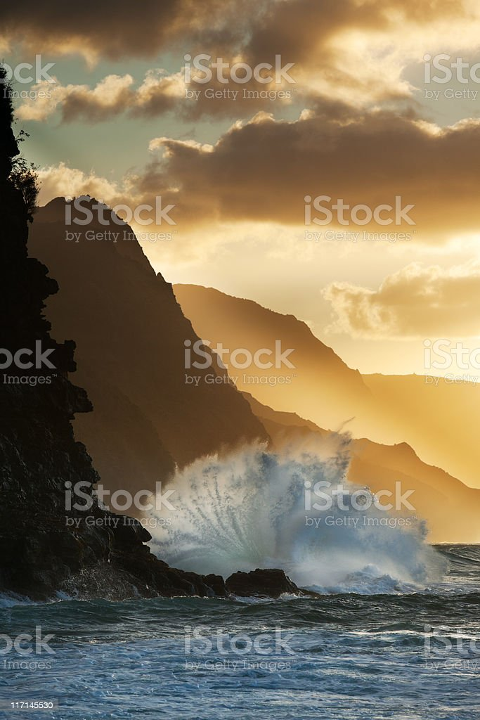 Surf smashing into Na Pali coast in Hawaii. stock photo