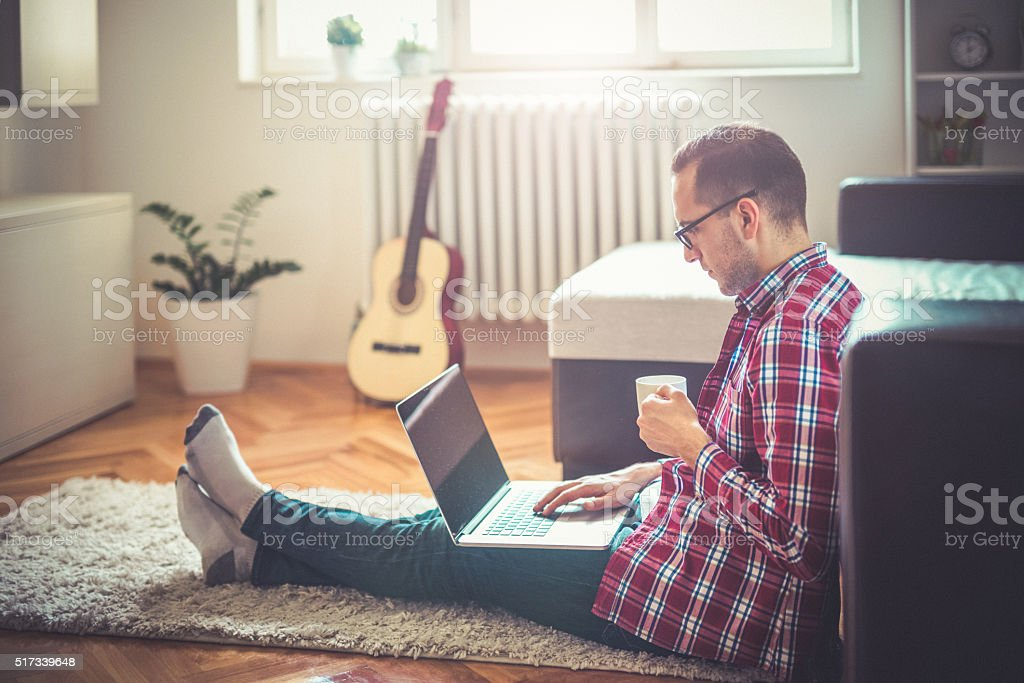 Surf the internet with lap top stock photo