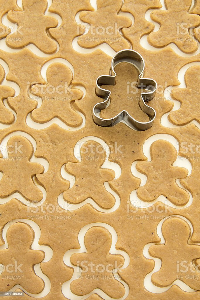 Surface full of gingerbread dough cut in man shape stock photo