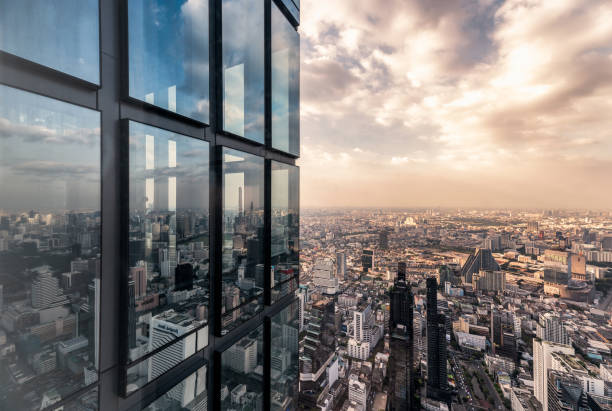Surface glass windows with crowded building in bangkok city stock photo