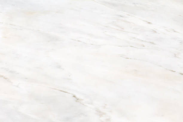 Surface is white polished marble with beige streaks. Background image, texture. stock photo