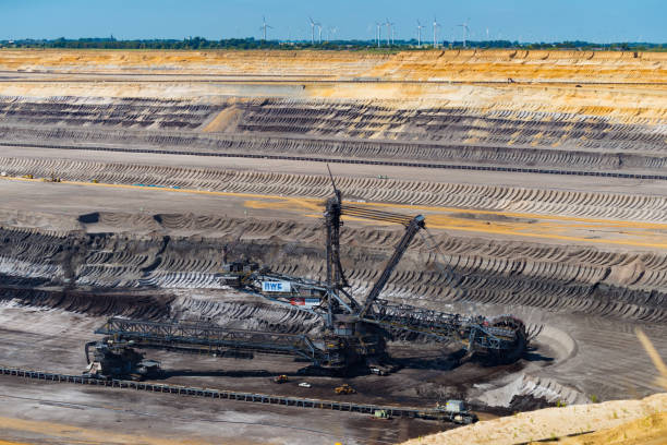 surface mining in Germany HOCHNEUKIRCH, GERMANY - JULY 7, 2018: enormous bucket-wheel excavator in an open pit lignite brown-coal mine tagebau stock pictures, royalty-free photos & images