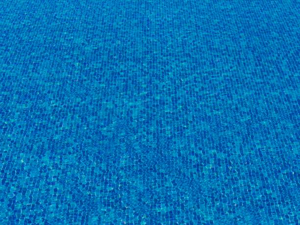 surface of blue swimming pool, background of water stock photo