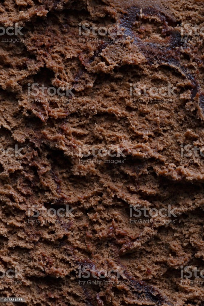 Surface of chocolate ice cream, sweet frozen dessert for summer breakfast. Photographed close-up. stock photo