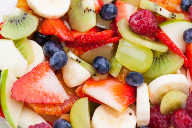 surface of cutted of fruit real edible fruits - no artificial ingredients used fruit salad stock pictures, royalty-free photos & images