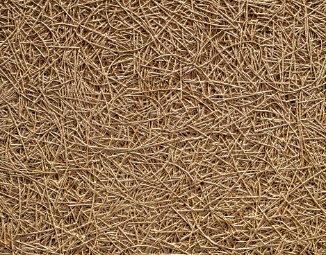 Chaotic surface of an insulating panel made of wood fibers. Texture close  up.