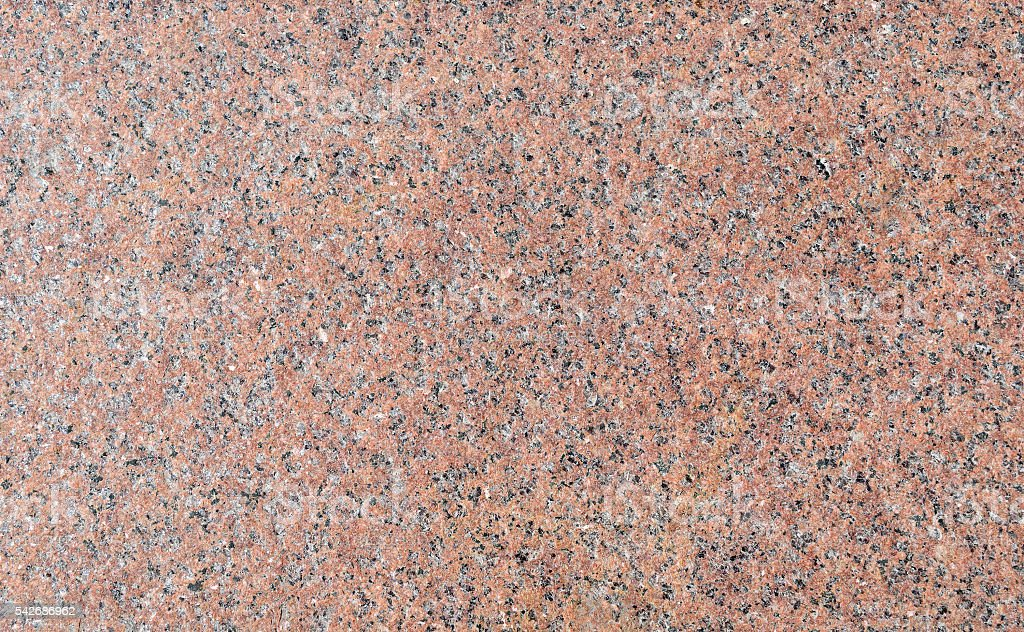 Surface of light pink granite with brown and gray patches stock photo