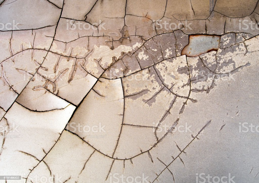 Surface of the old car paint cracked and disintegrated stock photo