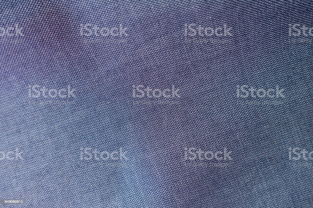 Surface of thin blue jeans fabric from above stock photo