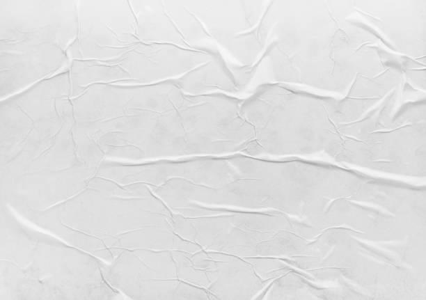 surface of wet crumpled glued paper - влажный стоковые фото и изображения