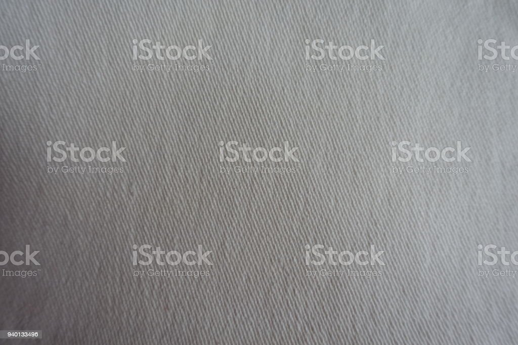Surface of white jeans fabric from above stock photo
