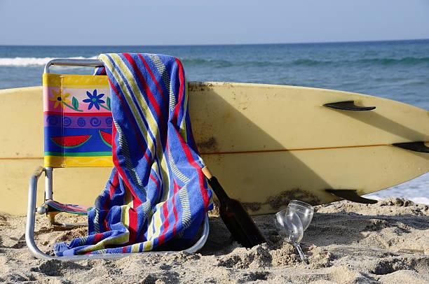 Surfboard, Beach Chair, Wine and the Ocean stock photo