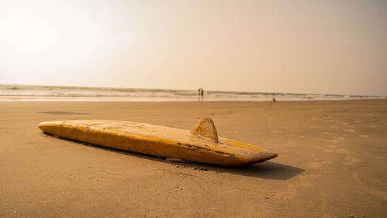 Surfboard lying on the beach in Goa, India