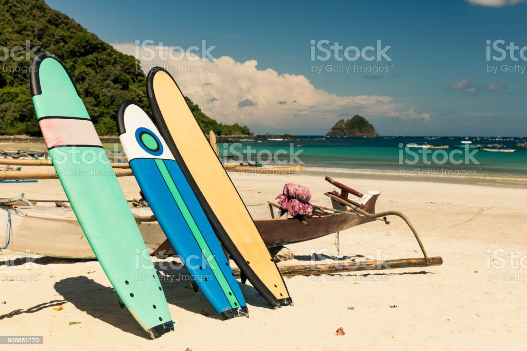 Surfboards and traditional Balinese boat stock photo