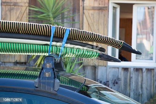 surfboards are on the roof of the car