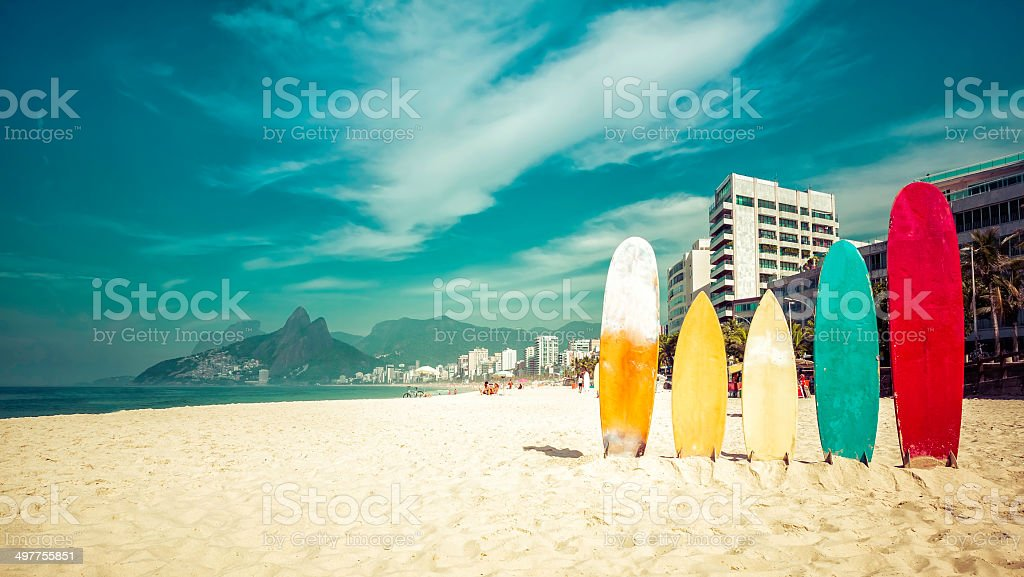 Surfboards in bright sun on the Ipanema Beach stock photo