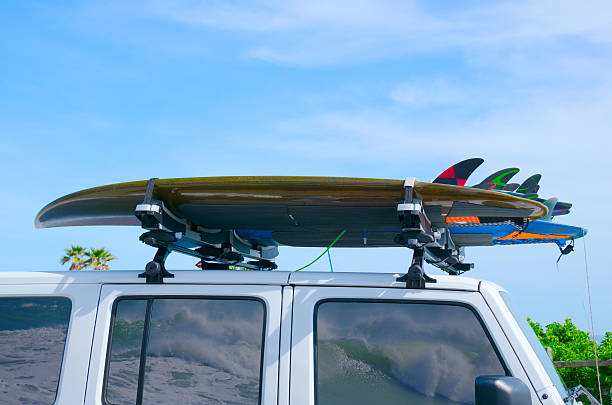 Surfboards on truck w wave reflections in windows stock photo