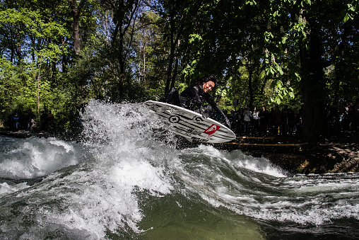 Surfer a the riverwave Eisbach