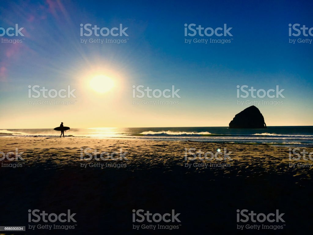 Surfer Alone on Beach stock photo
