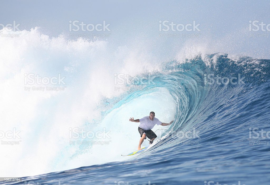 surfer and big wave barrel stock photo