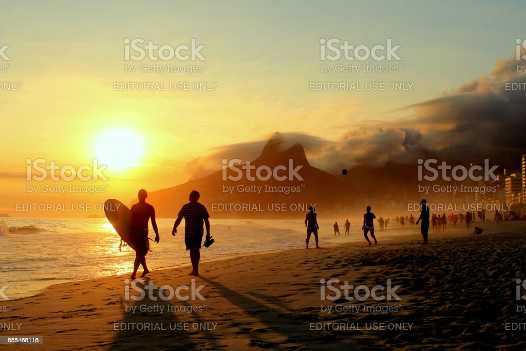 Surfer and his friend stock photo