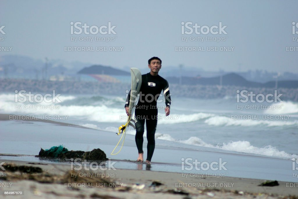 Surfer at Natori beach stock photo