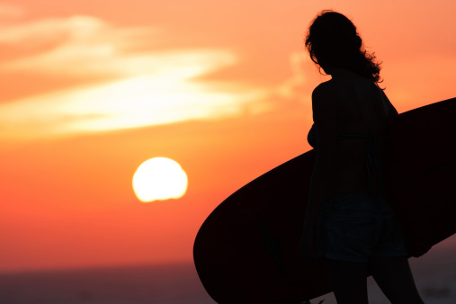 istock surfer at sunset 497210997