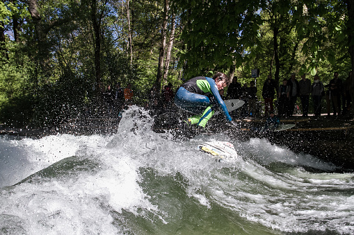 Surfer at the famous wave Eisbach