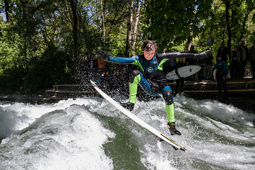 Surfer at the riverwave Eisbach in germany