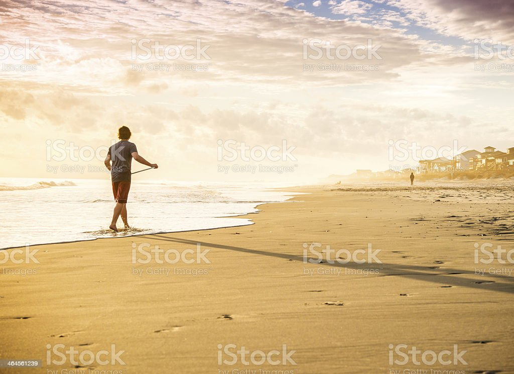 Surfer, beach and sunset. stock photo
