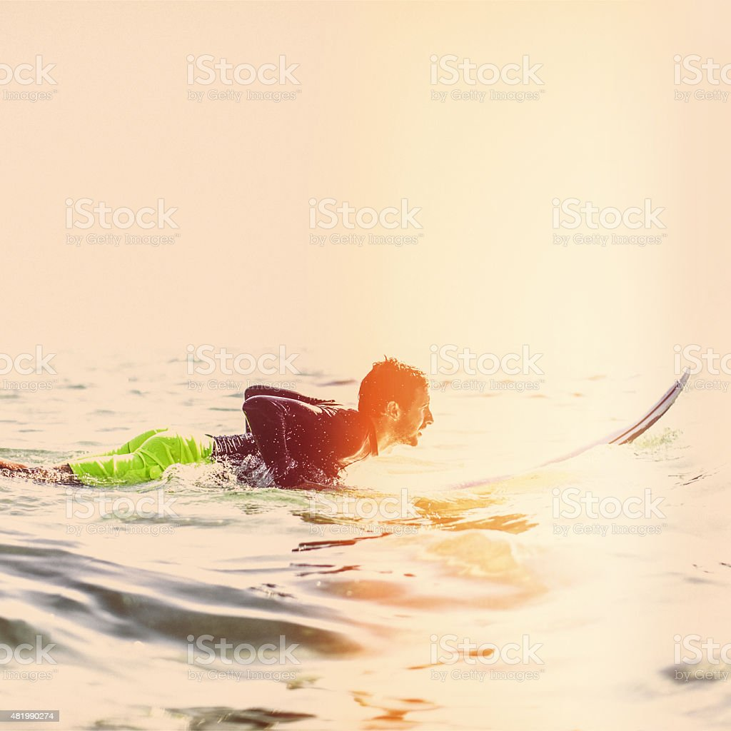 Surfer boy in action stock photo