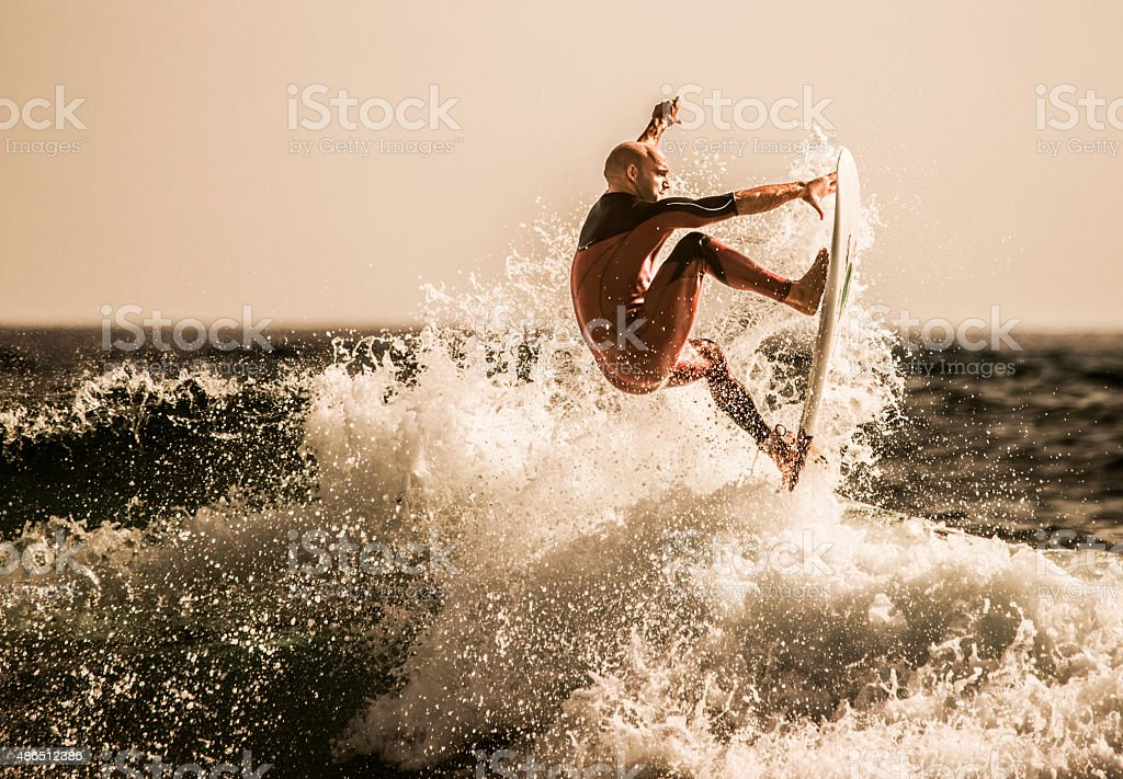 Surfer catching the best wave at sea. stock photo