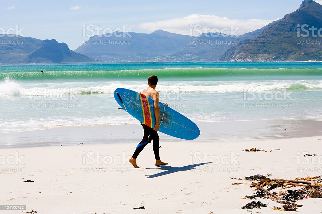 Surfer checking out waves stock photo