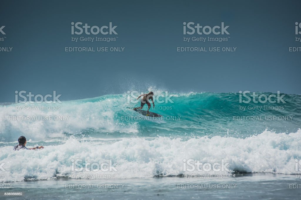 Surfer conquers waves stock photo