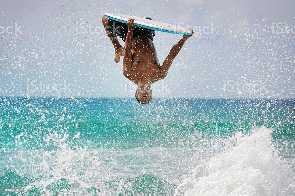 Surfer doing a backflip stock photo