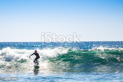 Single surfer on awesome wave.
