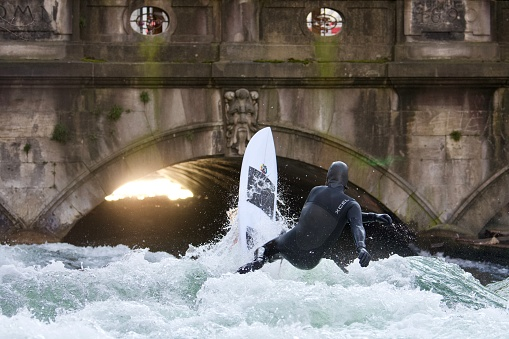 A surfer falling in the Eisbach river