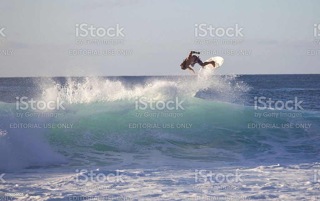 Surfer Flying Through The Air in Hawaii royalty-free stock photo